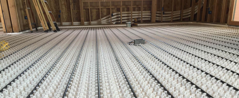 radiant floor heat peg system with PEX tubes