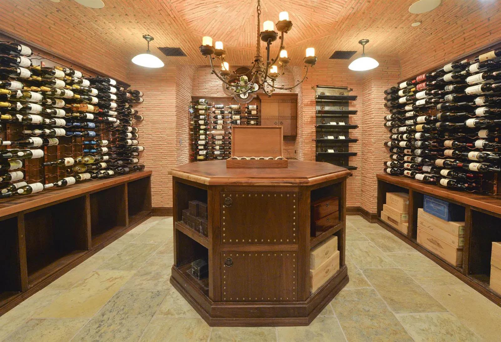 Beautiful wine room design with brick walls and ceiling.