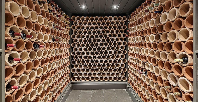 Contemporary wine cellar design. Single bottle tube wine racks.