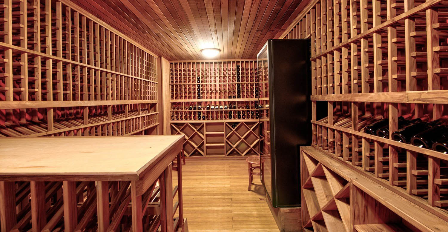 large wine cellar with wood racks huge room for thousands of bottles