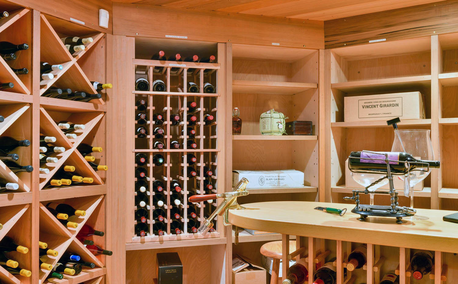 light wood wine racks with shelving and center table