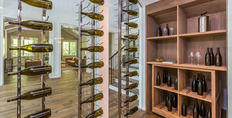modern wine room. Glass walls with metal racks wood shelving.