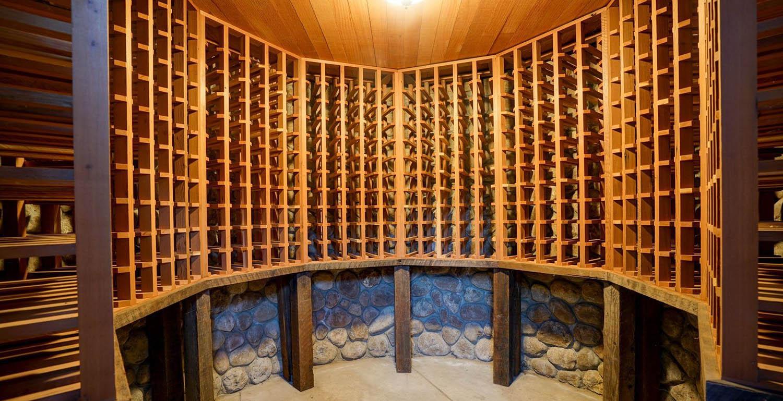 round wine cellar design wood racks stone walls