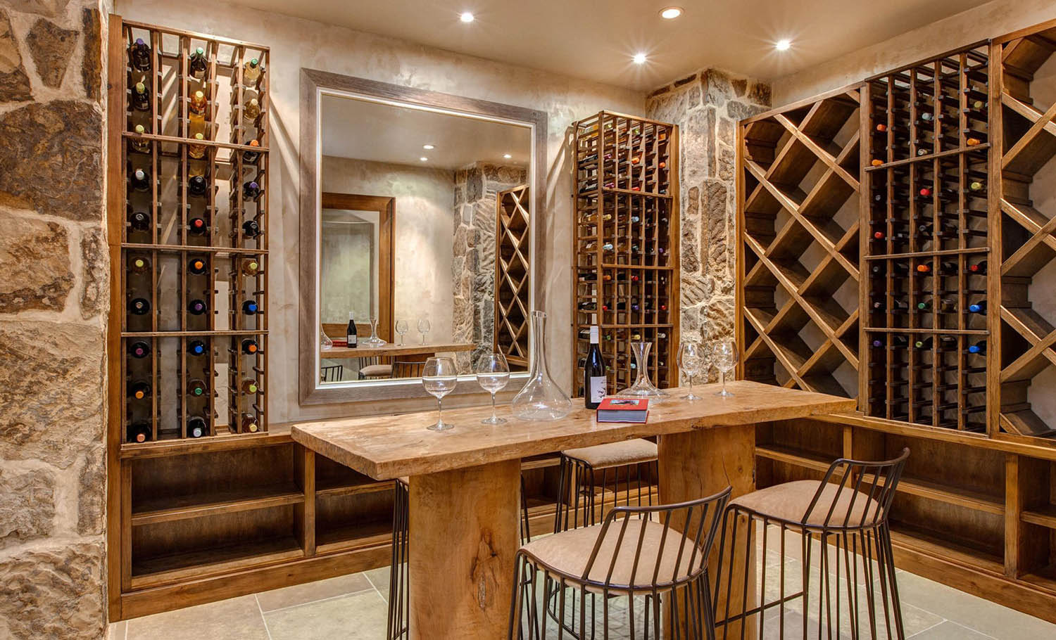 classic wine room style stone walls and wood racks wood center tasting table