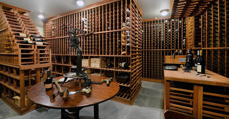 large wine room with lots of wood wine racks