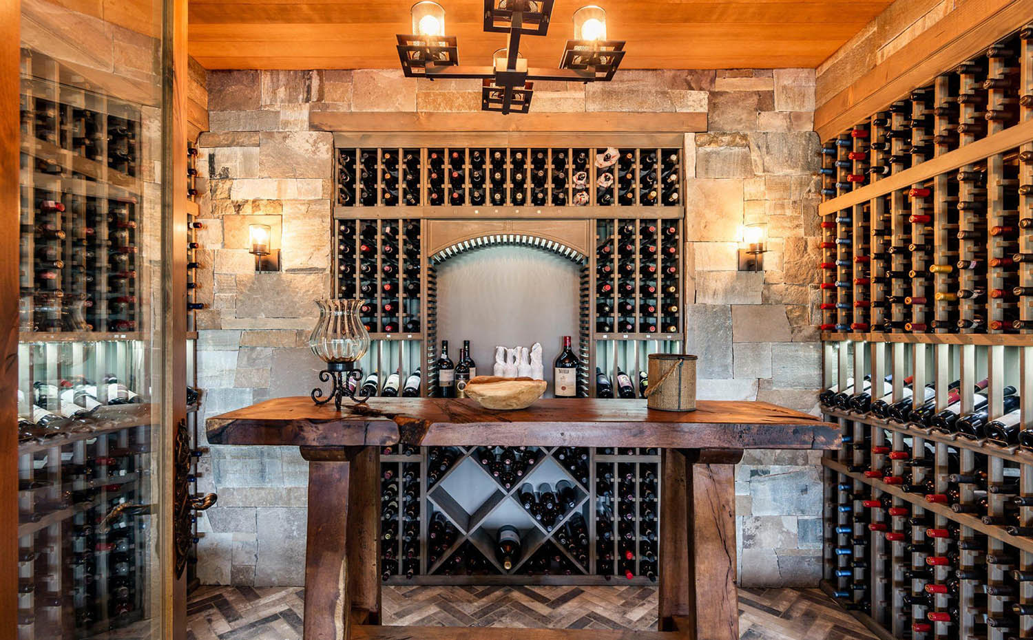 rustic wine room design wood wine racks stone walls and wood center table wood ceiling
