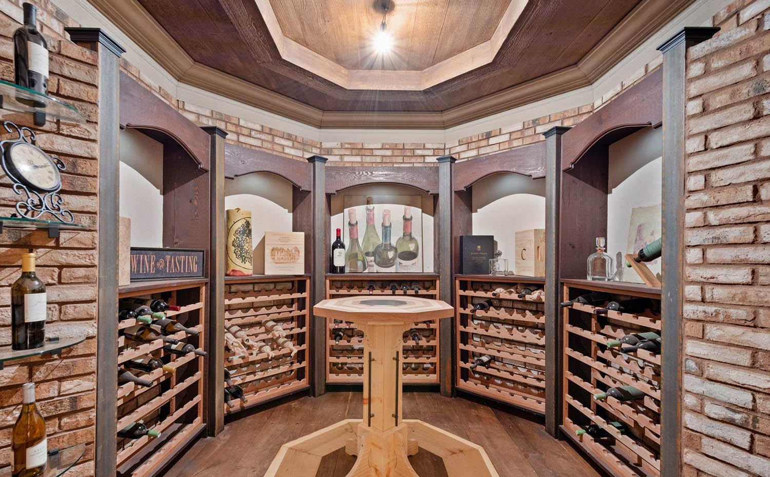round wine room with brick walls and wood racks