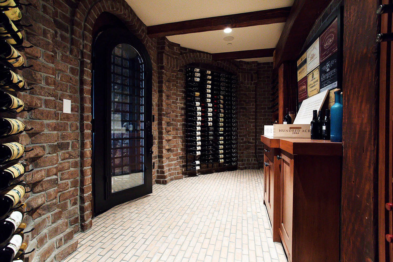 Beautiful wine room with brick walls and dark wood
