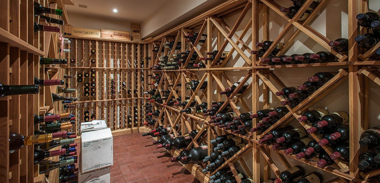 Simple DIY wine cellar design. Diamond and single bottle wooden racks.
