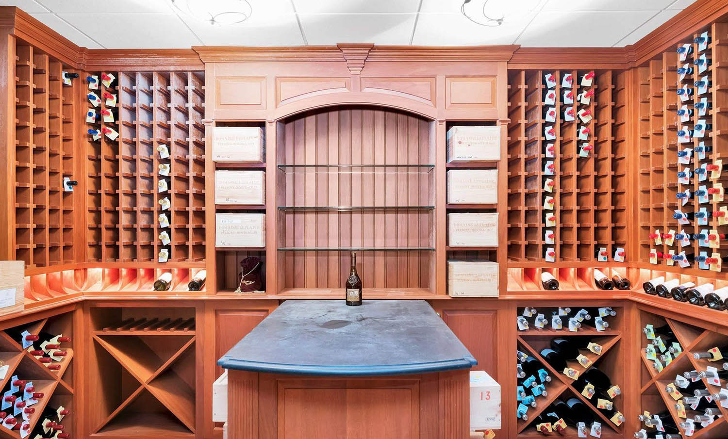 beautiful wine room design with wood racks and center island