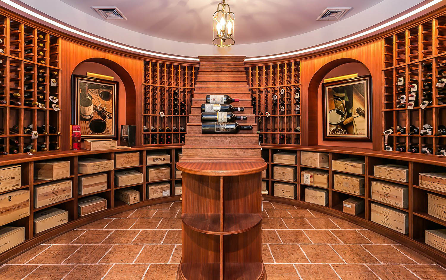 Rustic wine cellar with stone walls and wood ceiling. Custom built wood wine racks with a wood center tasting table. Glass doors.