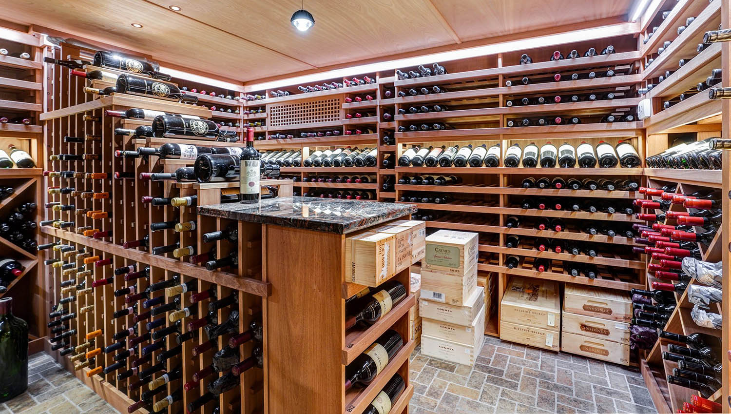 Large wine cellar with wood racks and tasting counter.
