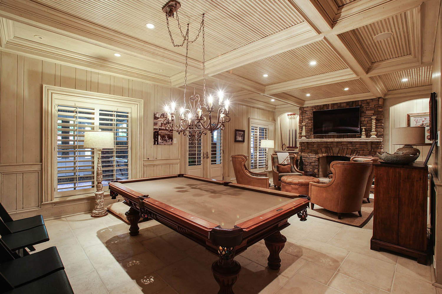 Game roof with wood walls and light colored all wood coffered ceiling with bead board coffers.