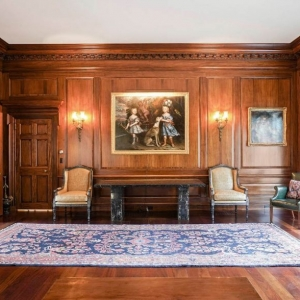 Great room with all wood walls and custom trim. Thick crown molding. Hardwood floors.