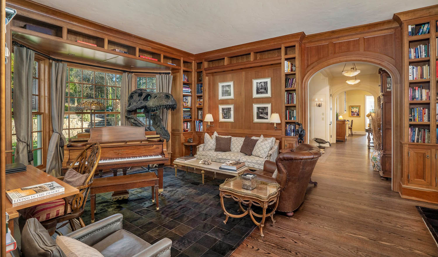 All wood walls with arched doorway. Woof floors with area rugs. Wood built ins.