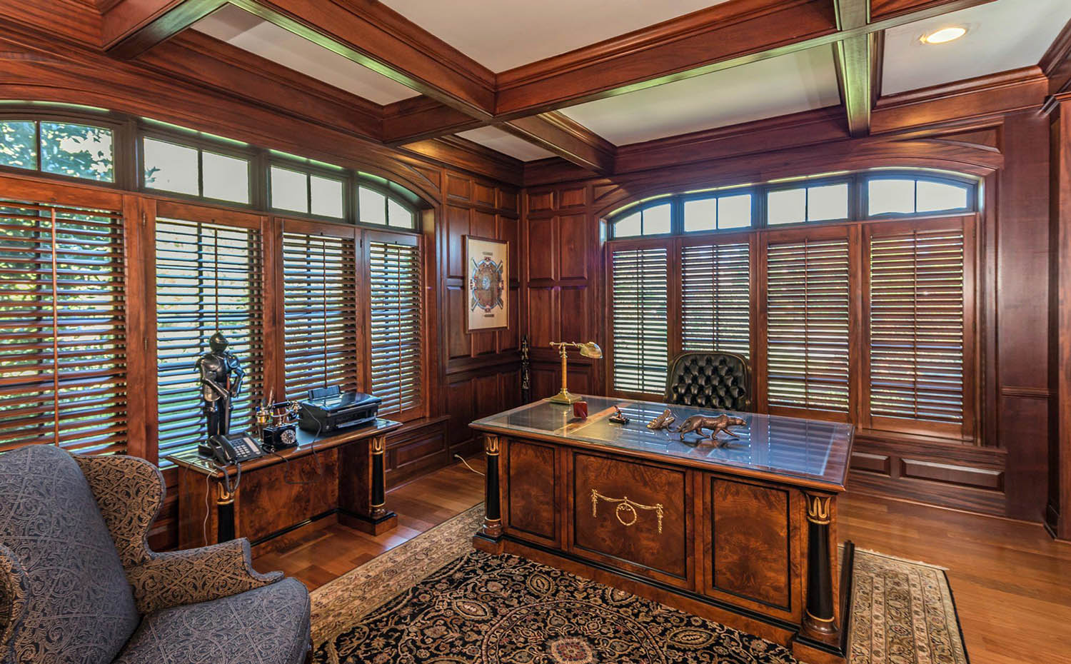 Wood walls and coffered ceiling stained medium brown. Matching hardwood floors.