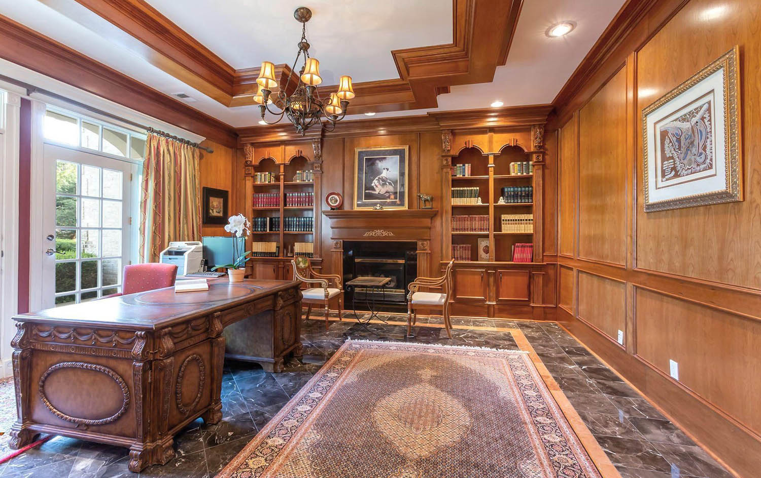 home office with all wood walls. Large panels with box trim. Thick crown molding and coffered ceiling
