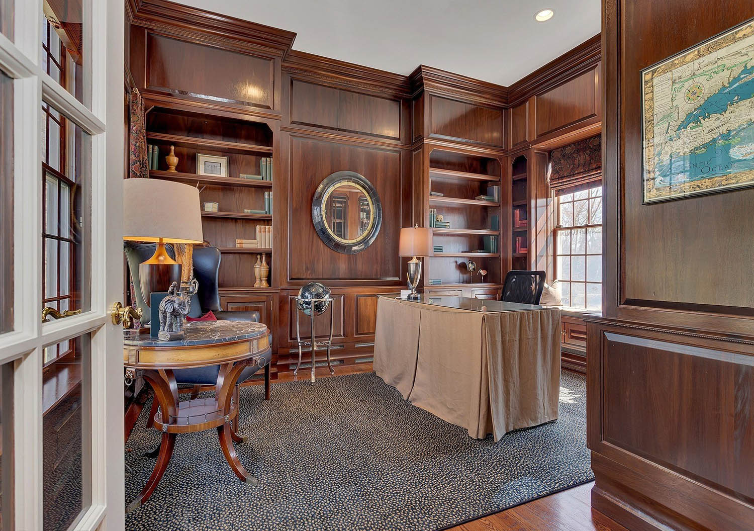 Home office with a clean wood wall panel design. Medium dark brown stain with a hint of yellow