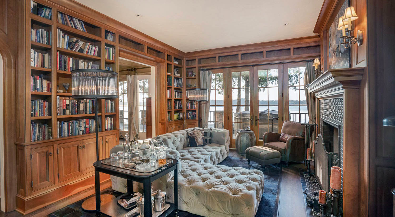 Beautiful sitting room with all wood walls and a water view. Built in shelves and cabinets.