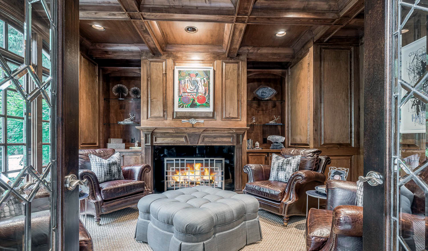 Lounge with real wood wall paneling and matching coffered ceiling. Wood beams with wood coffers, recessed lighting.