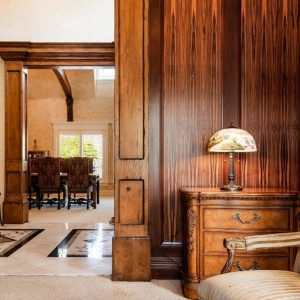 Sitting room with wood walls and custom wood columns. Carpet and tile floors.