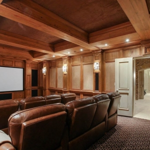 Wood theatre room with customwood coffered ceiling. Medium brown stain.