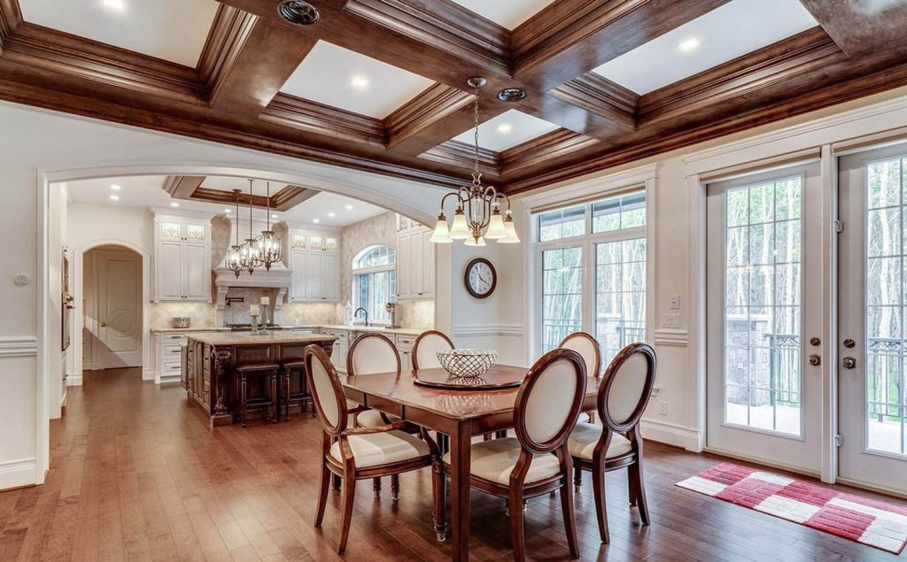 stained wood dining room coffered ceiling with grid pattern and center chandelier