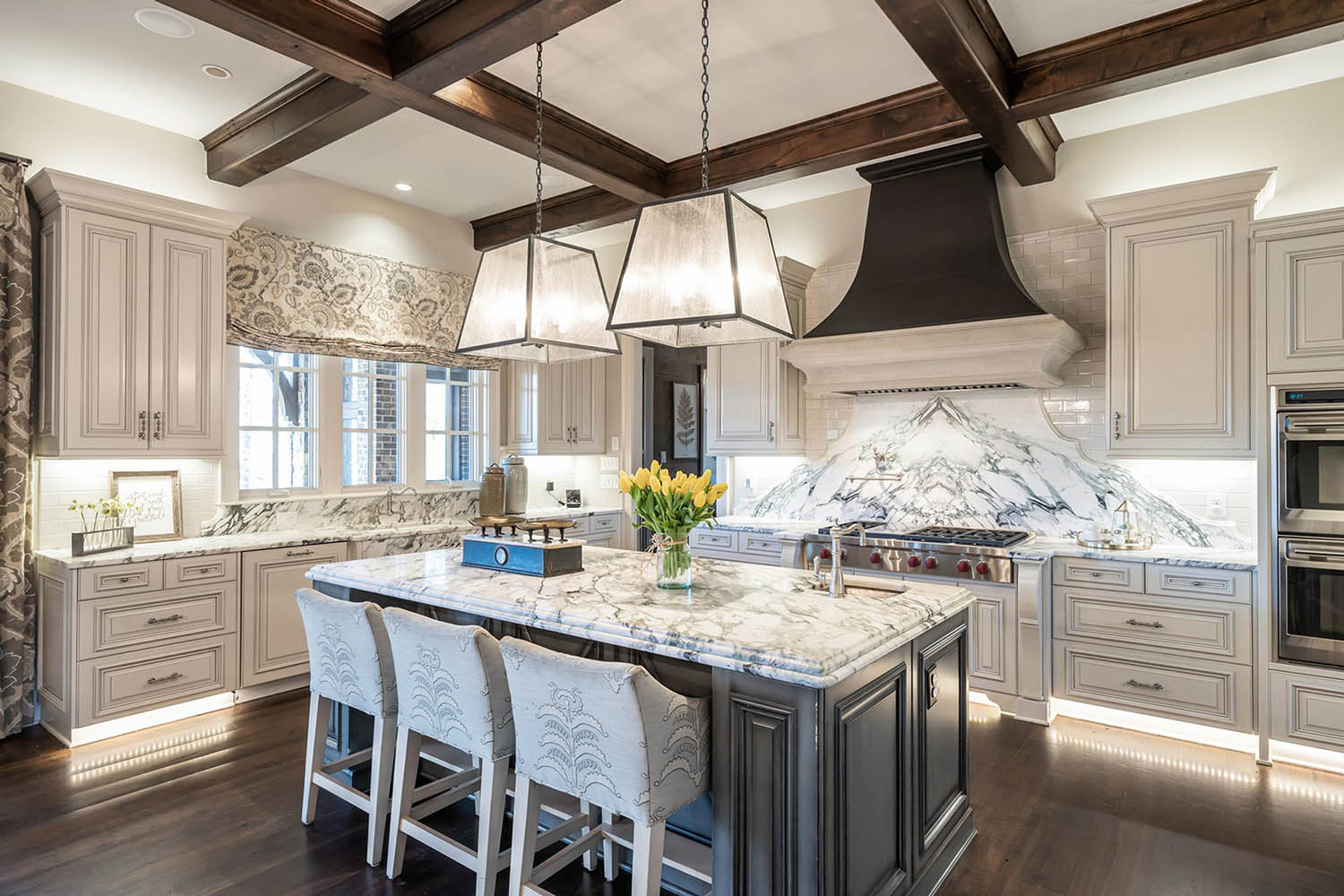 Luury kitchen with dark wood coffered ceiling beams lots of marble