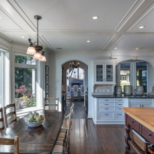 Low profile coffered ceiling in an open floor plan kitchen, dining and living room.