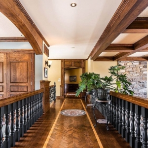Real wood solid timber dropped beam coffered ceiling in a rustic styled home.