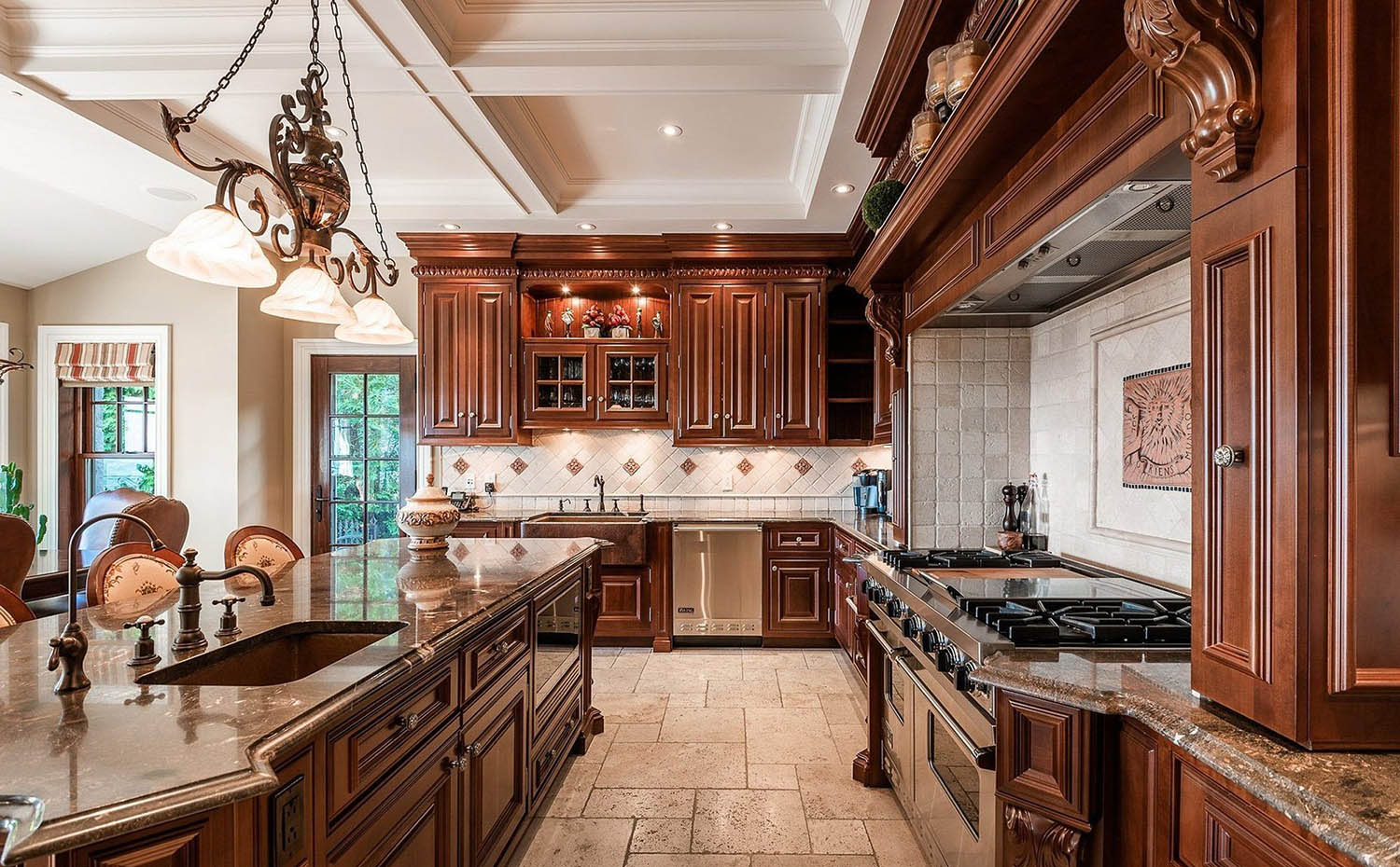 Wood Cabinets With A White Coffered Ceiling and dark countertops custom kitchen