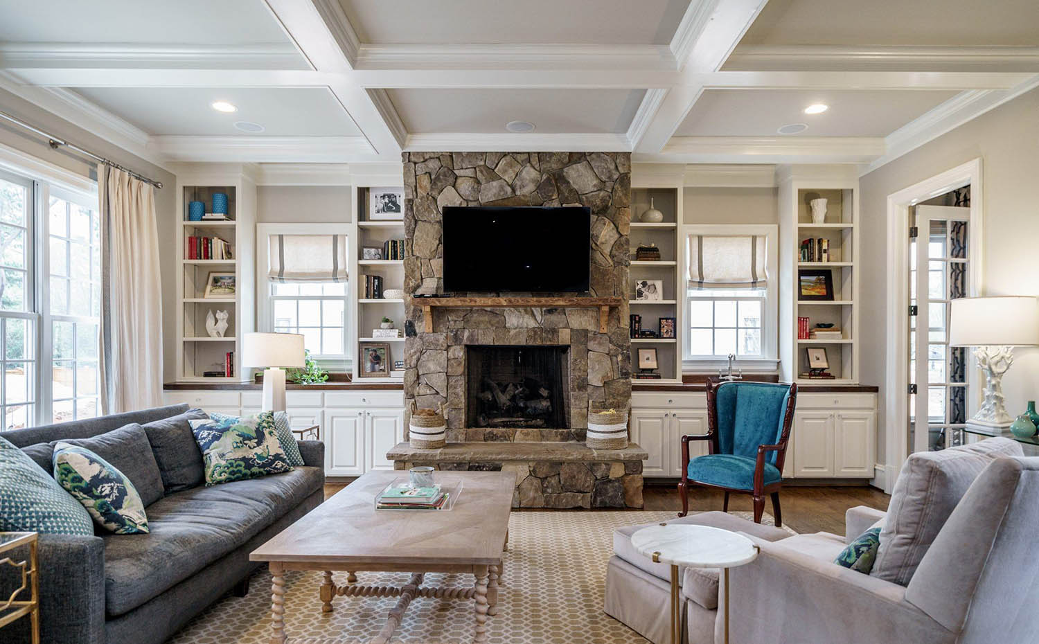 living room coffered ceiling with two toned design and real stone fireplace surround
