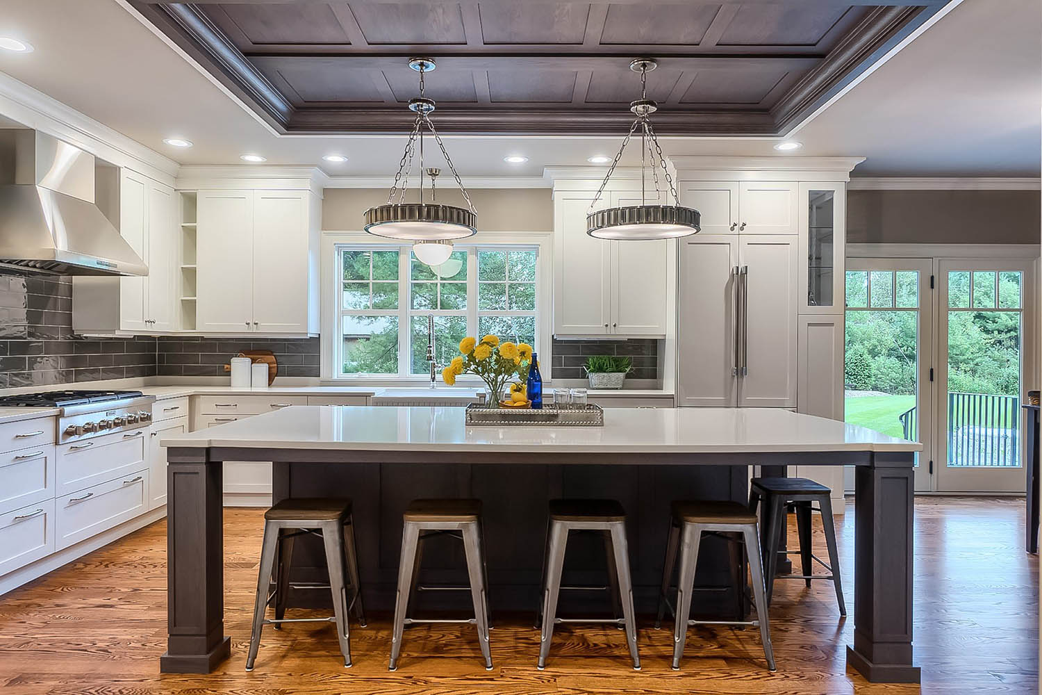 dark brown kitchen coffered ceiling with soffits and pendant lighting