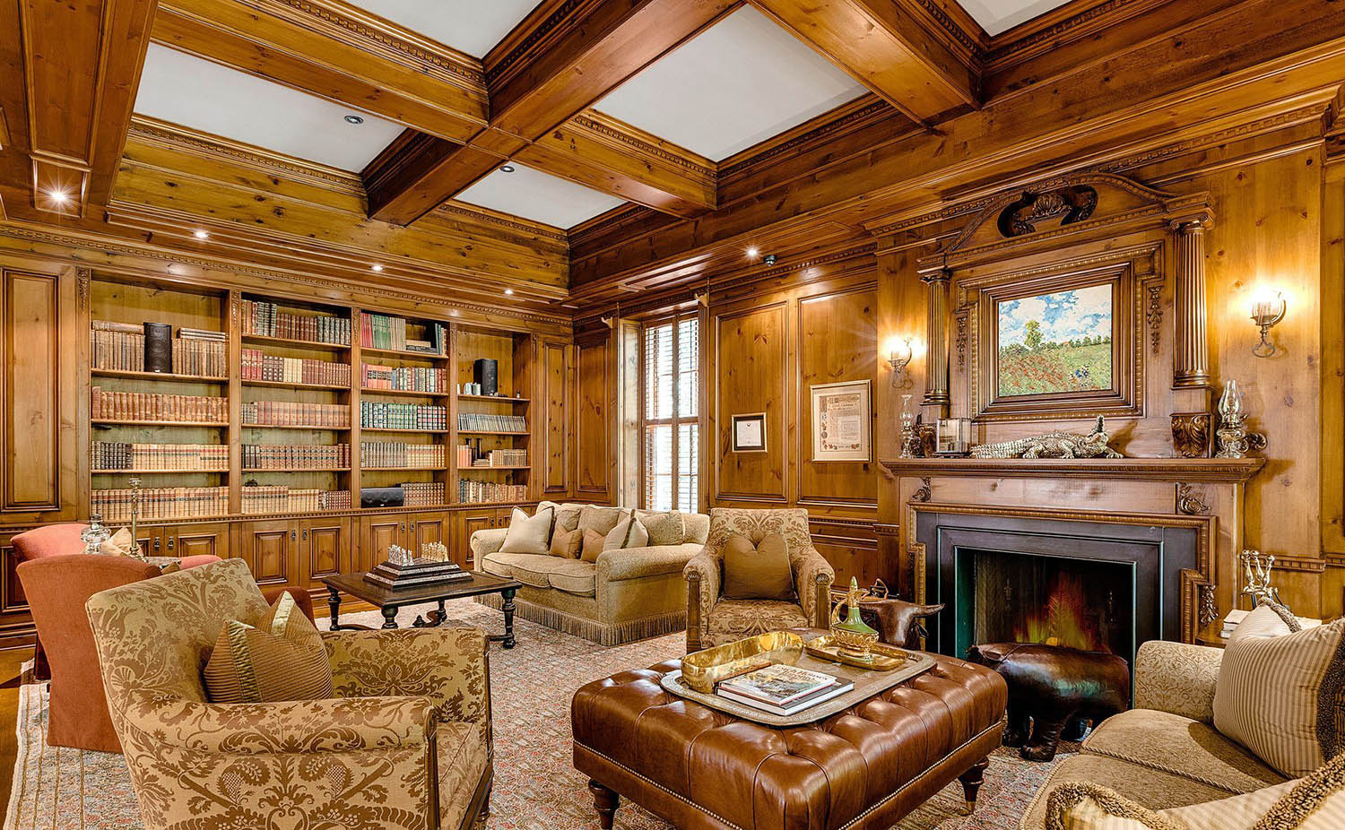 Study with wood walls and matching wood coffered ceiling. Wood beams with white coffers.