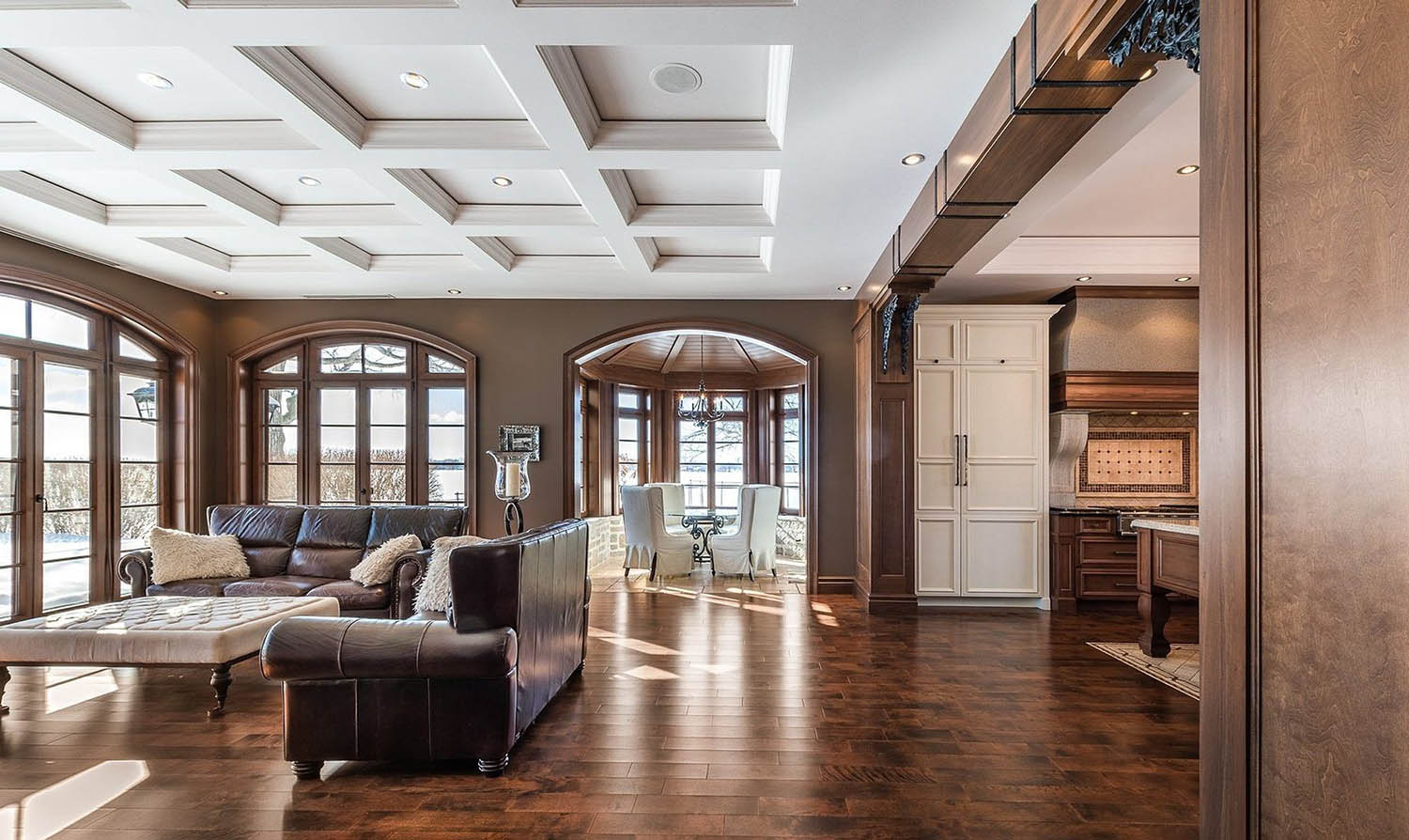 sheetrocked coffered ceiling with dropped soffit in the living room brown walls