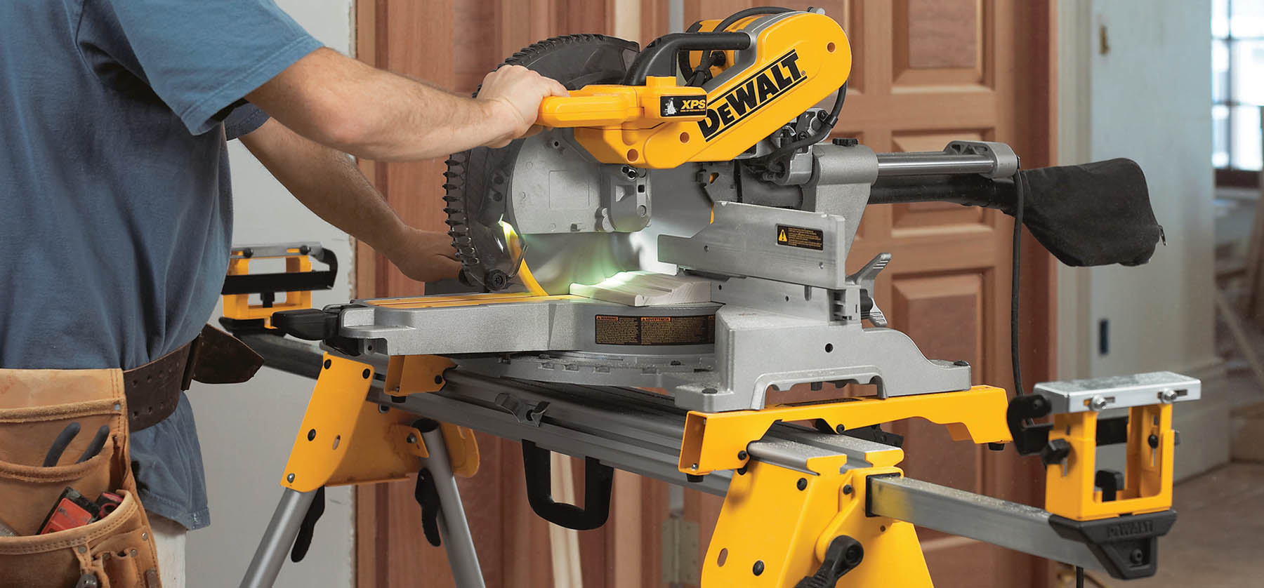 A miter saw being used essential woodworking tools for beginners basic power tools