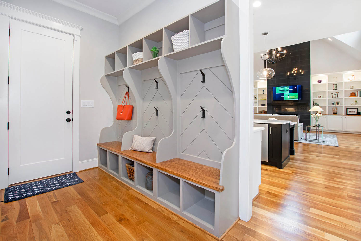 gray mudroom storage units with a wood bench top