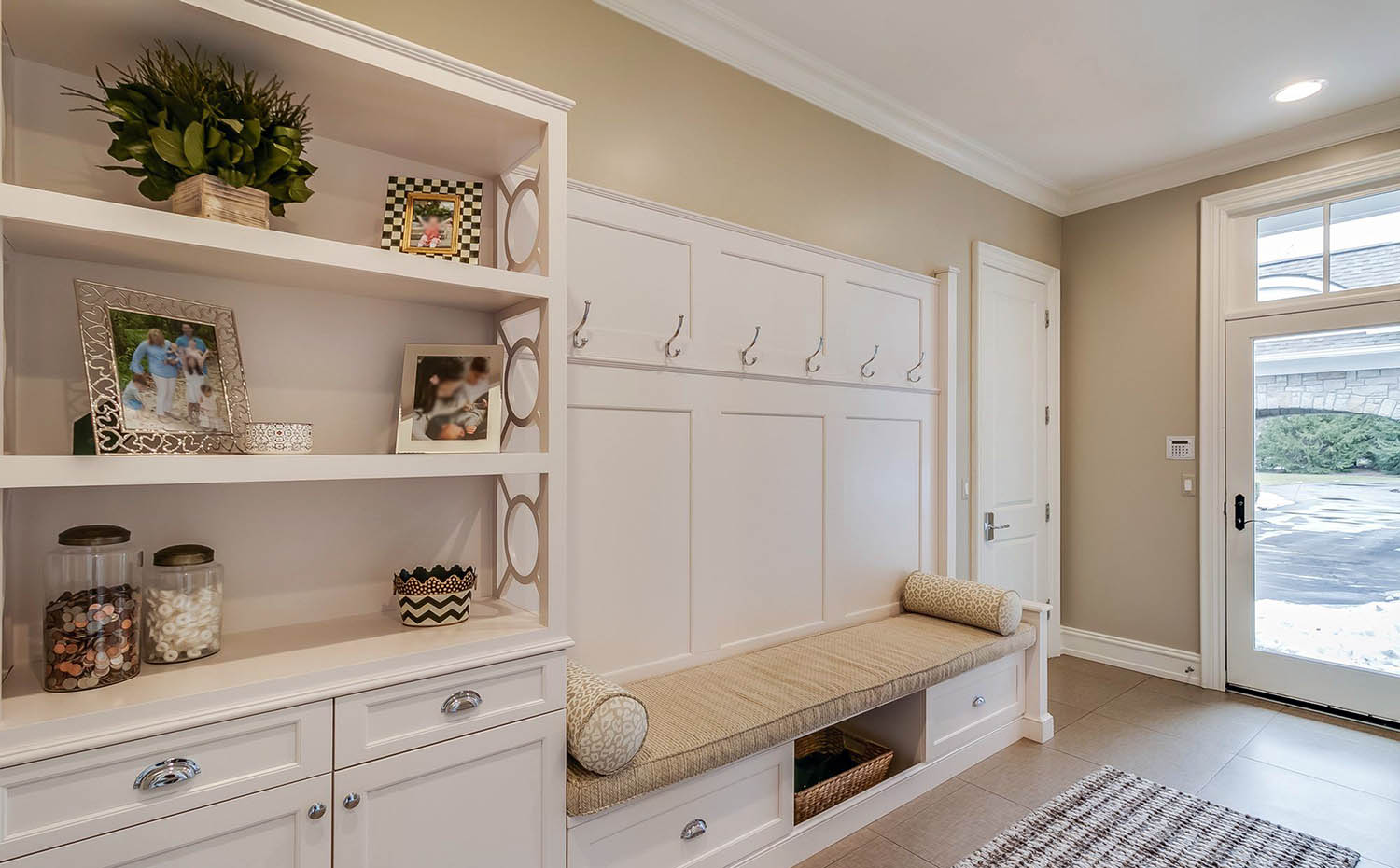 matching mudroom storage and furniture with plush tan seating
