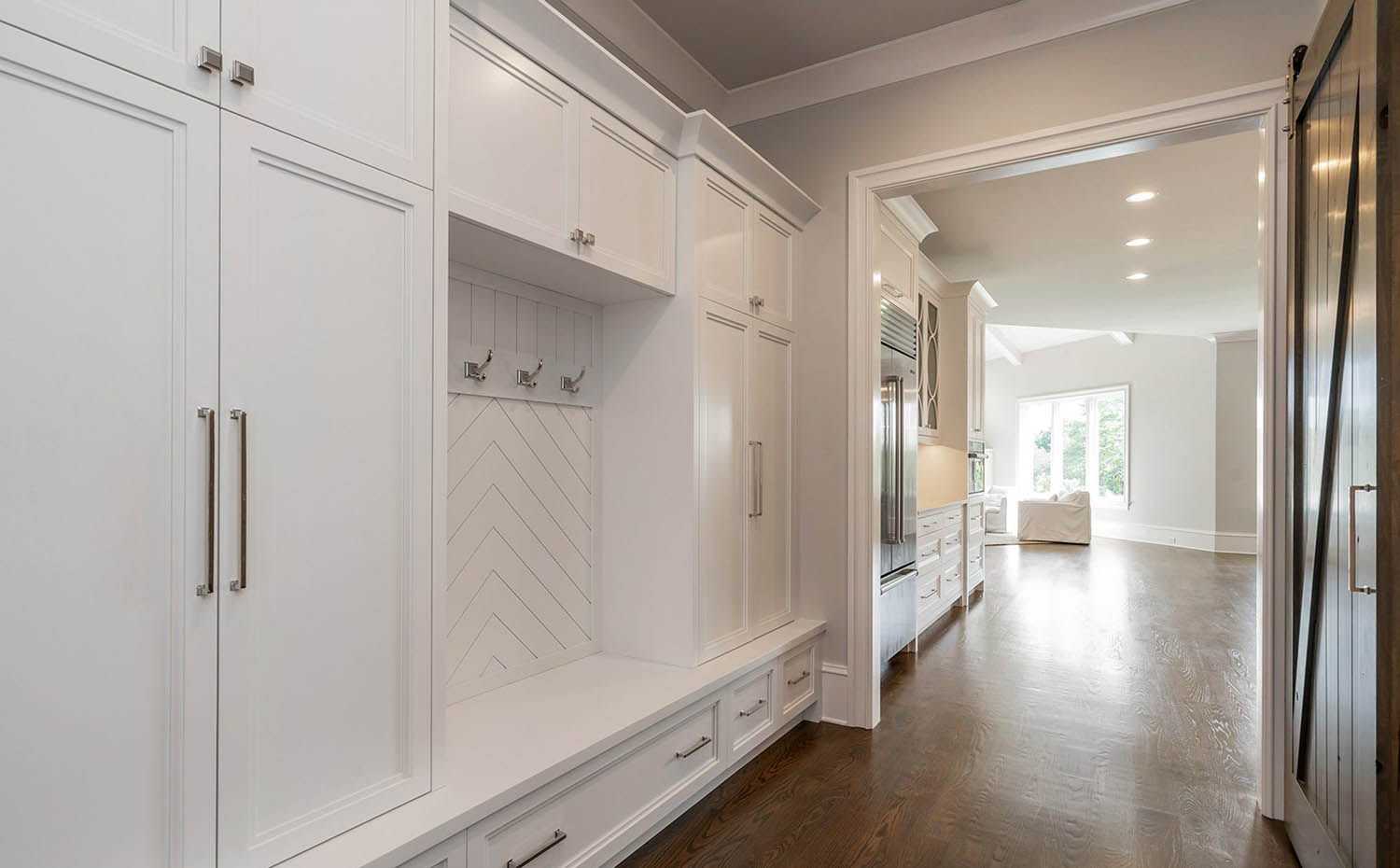 large white mudroom storage unit with base drawers high cabinets and long cabinets for coats