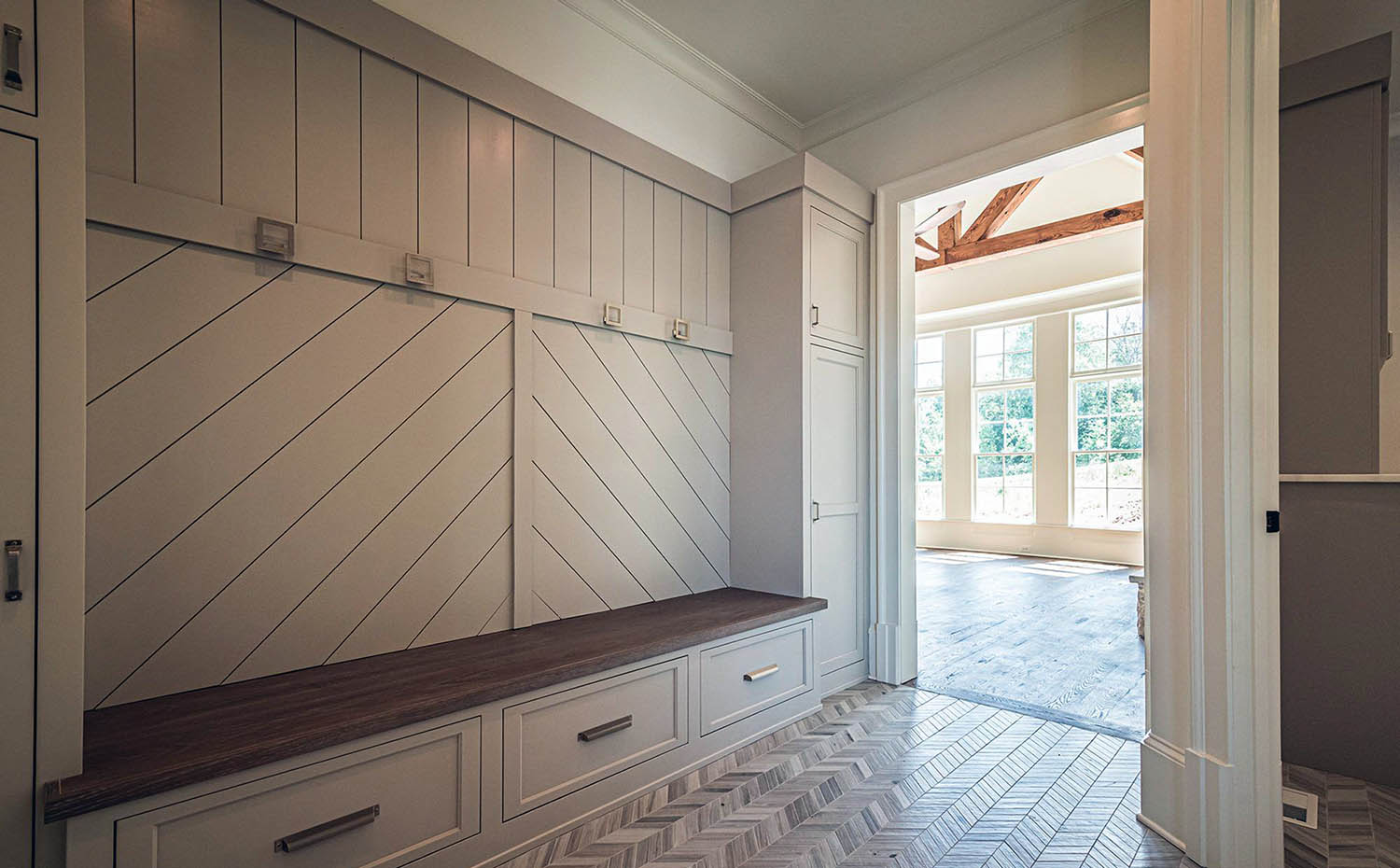 large gray and wood mudroom storage unit