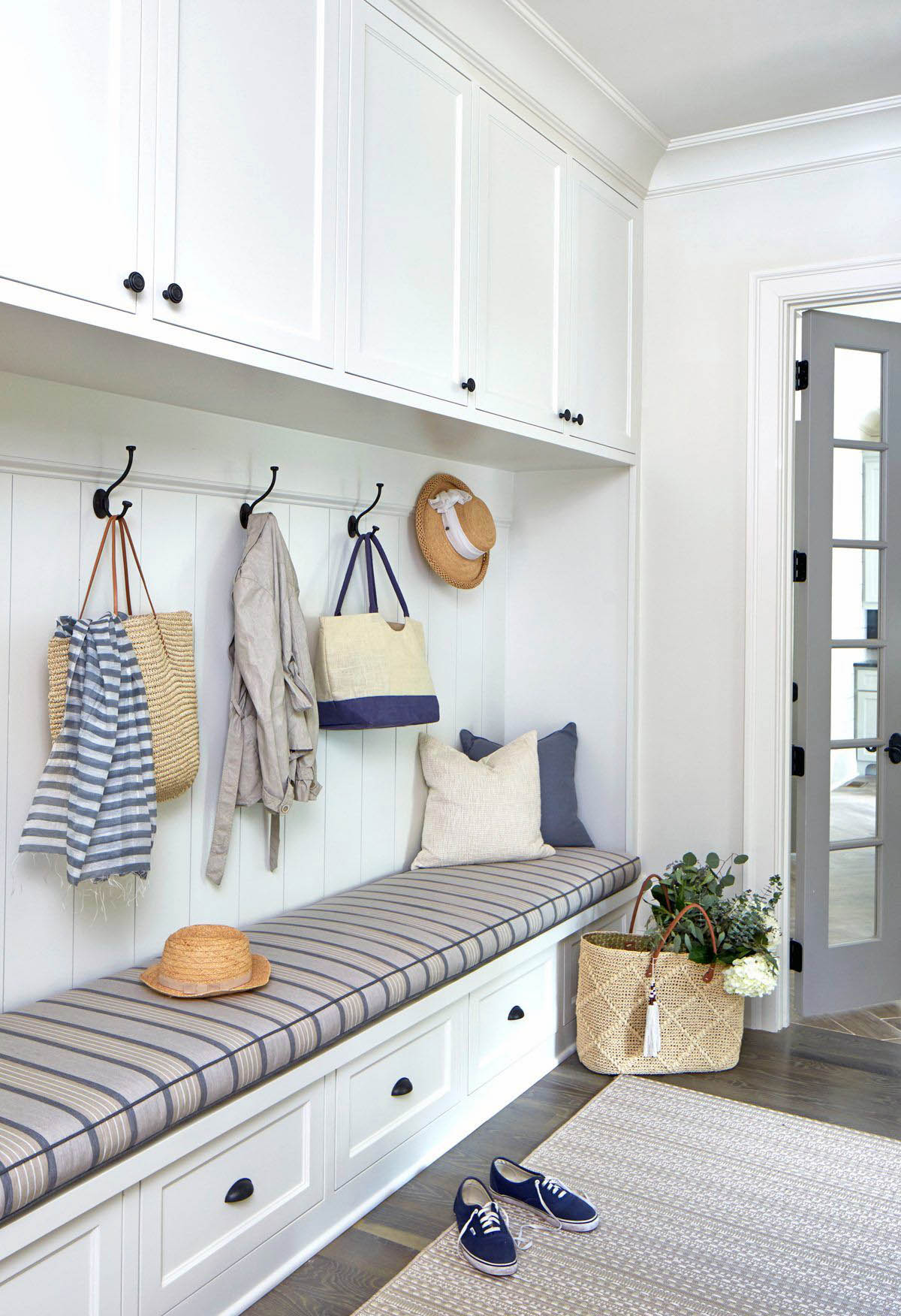 beautiful small mudroom storage unit design idea plush bench seating cushion with drawers and cabinets white paint with black knobs and coat hooks