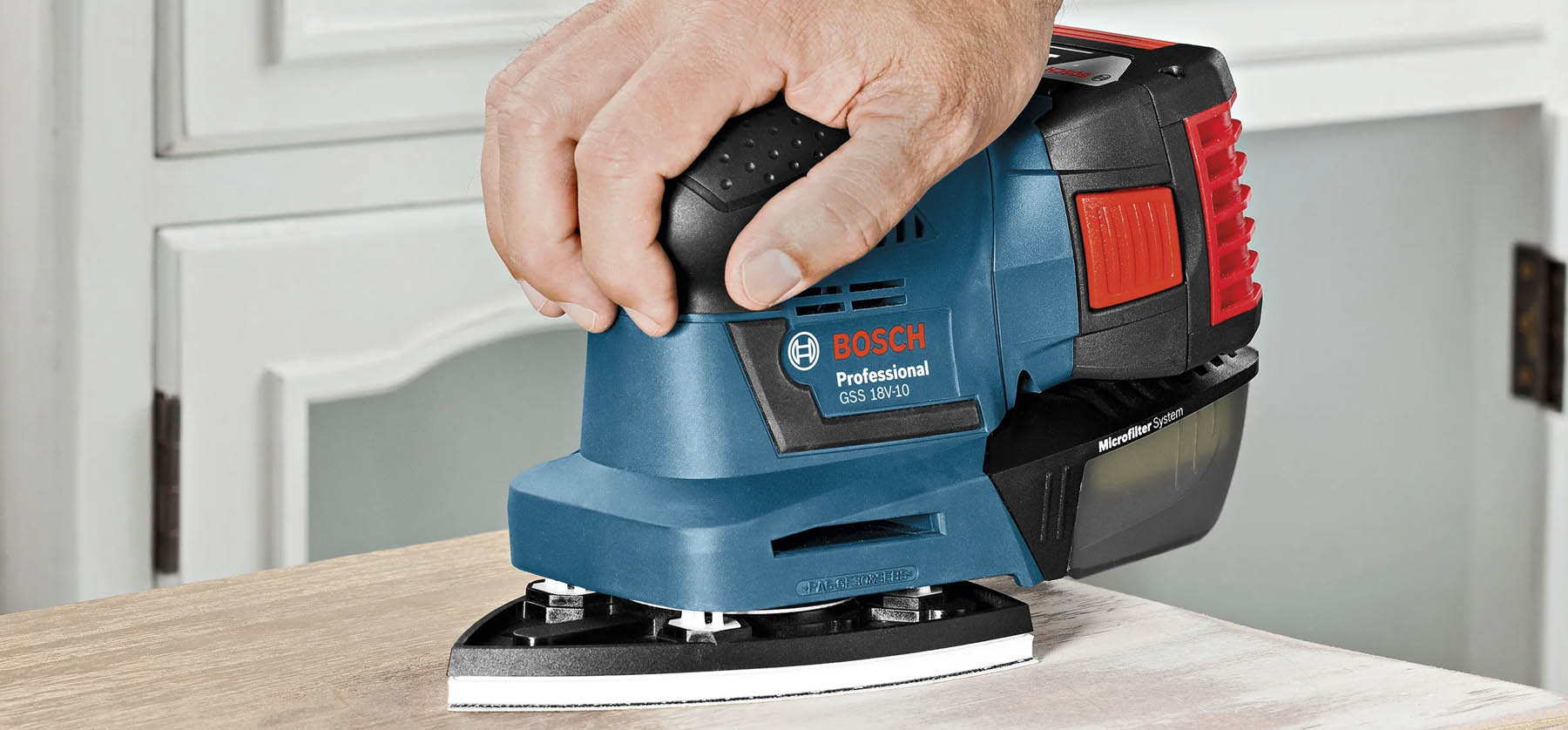 palm sander being used basic essential tools for woodworking beginners