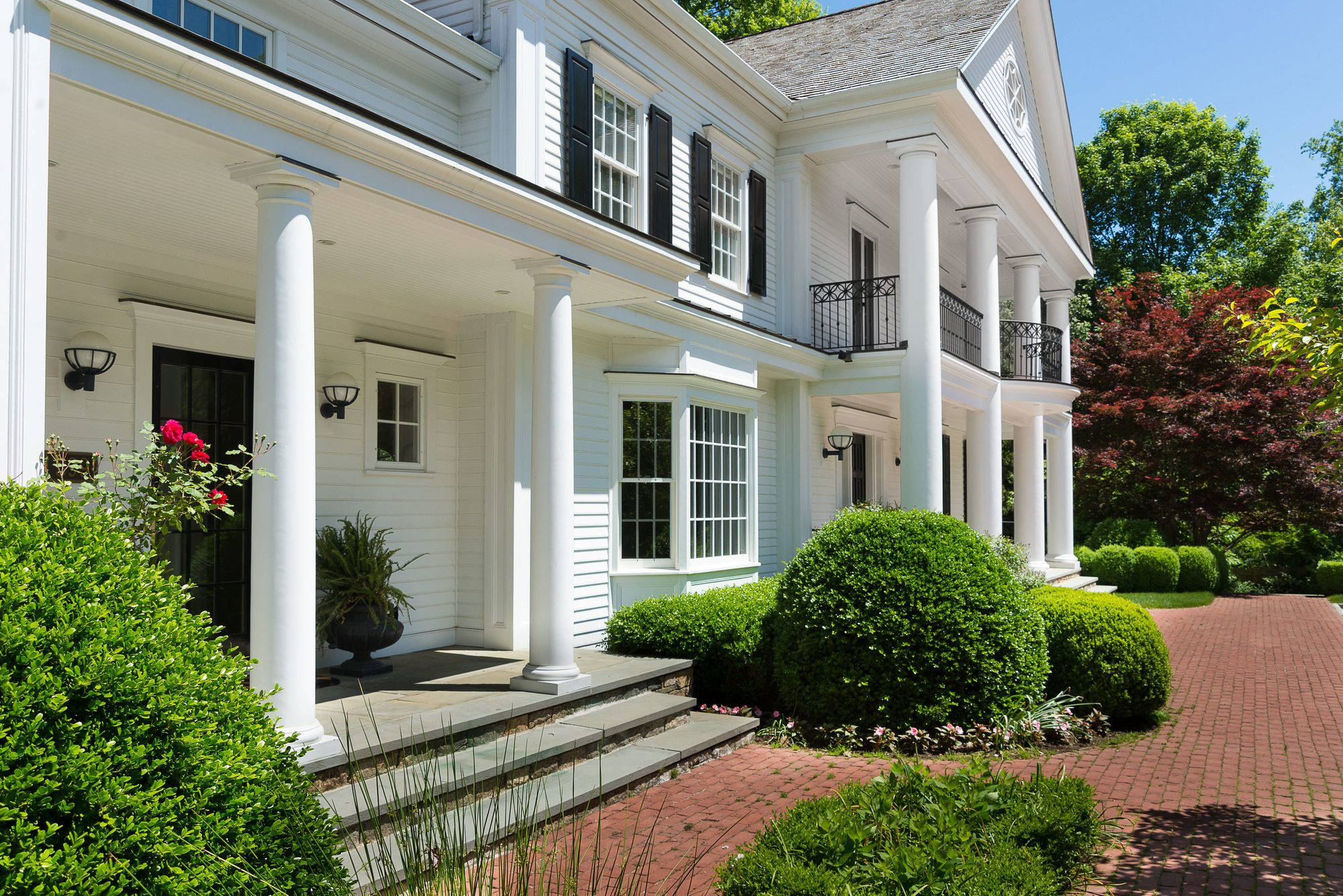 White colonial with white soffits and fascia including recessed LED lighting. 2nd Floor soffits include recessed LED lighting.