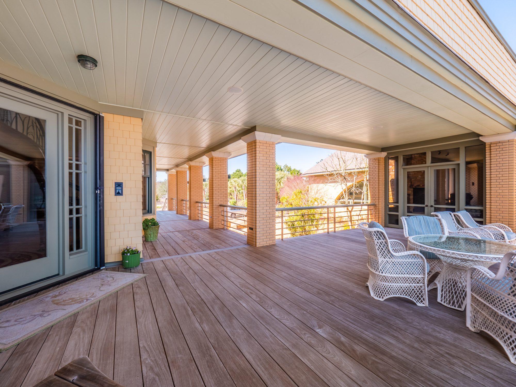 Cream colored vinyl soffit and matching fascia. Cream brick columns and cedar shake siding.