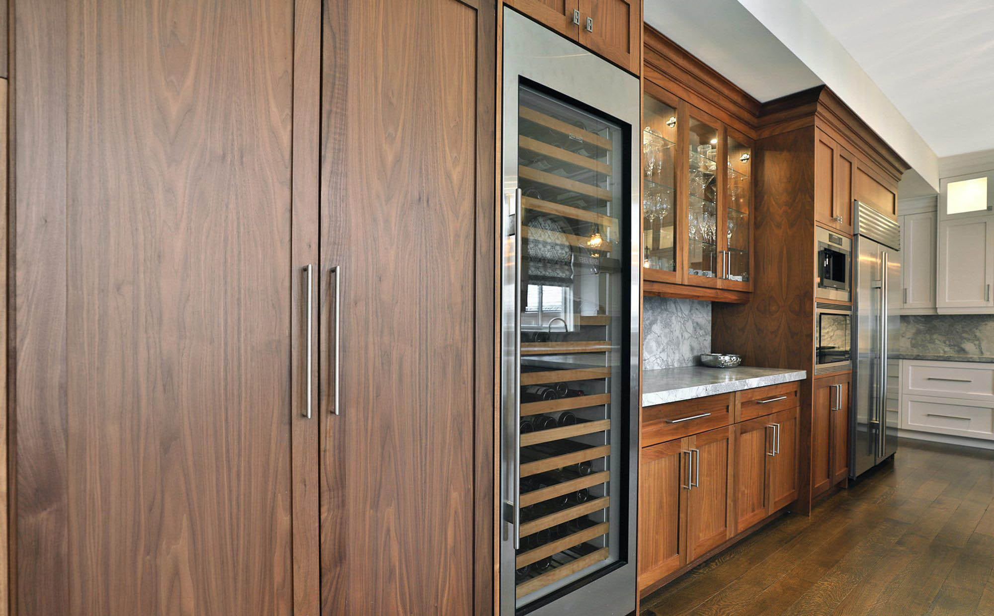 Beautiful wood cabinetry and built in refrigerator door panels. Rich brown stain with an egg shell varnish.