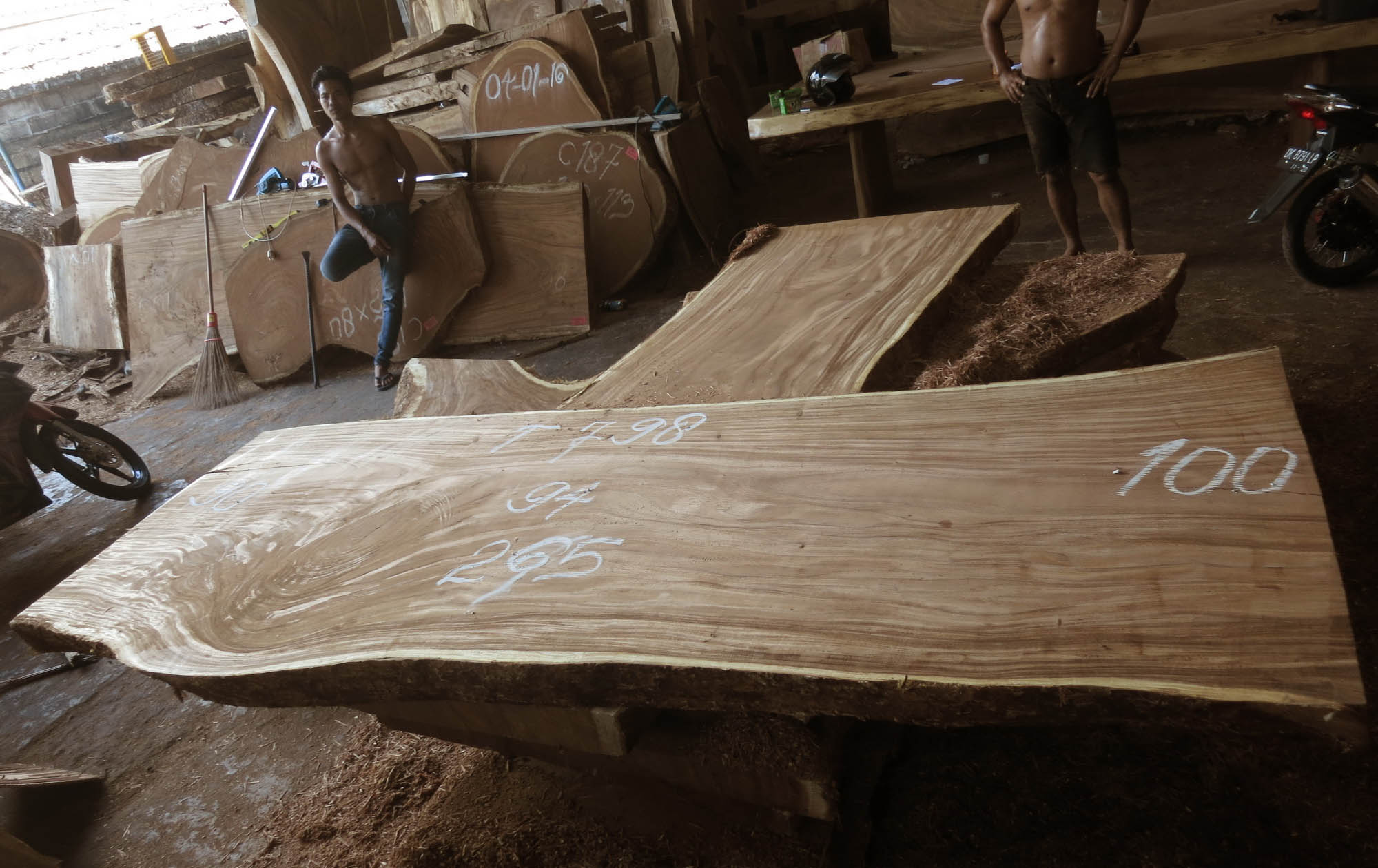 Acacia wood marked and ready for sale at the wood dealer