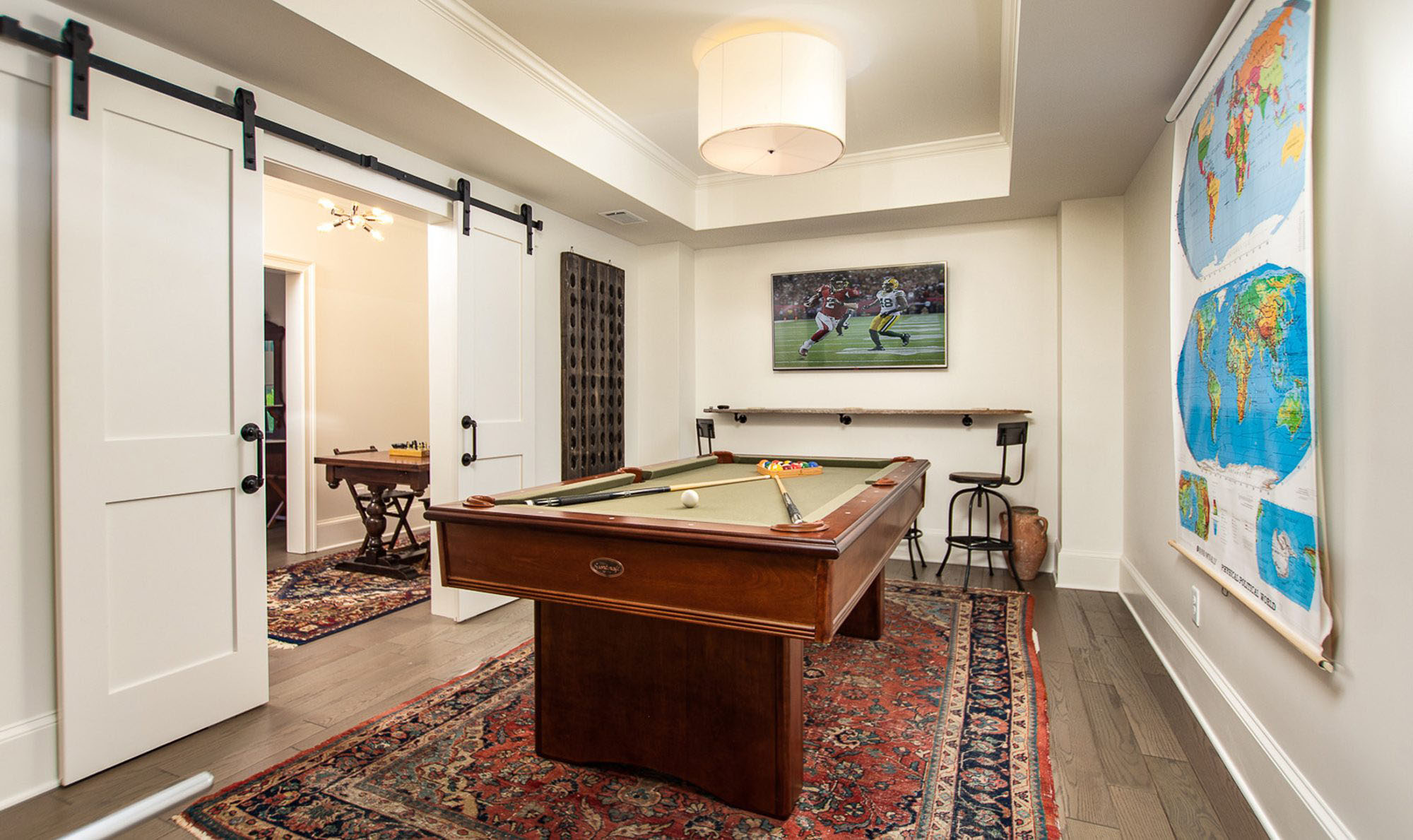 antique style area rug in a game room under the pool table