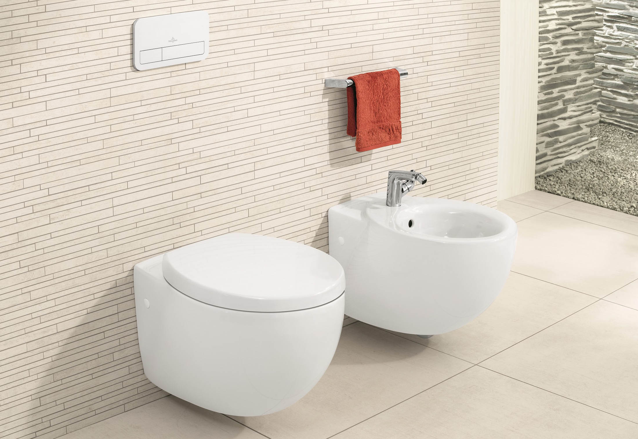 side by side matching toilet and bidet wall mounted at standard height
