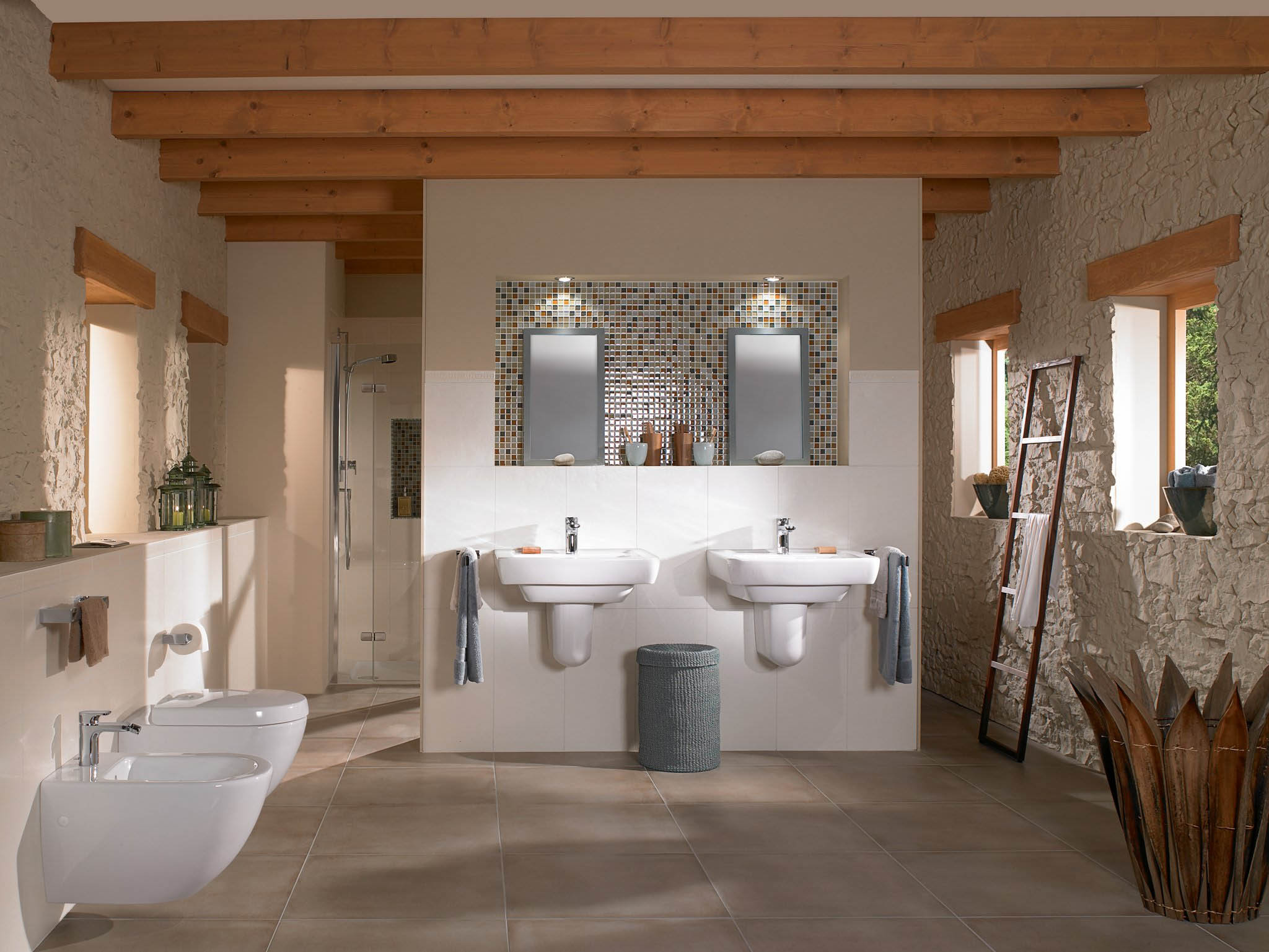 Rustic master bathroom with wall mounted toilet and bidet with matching double sinks