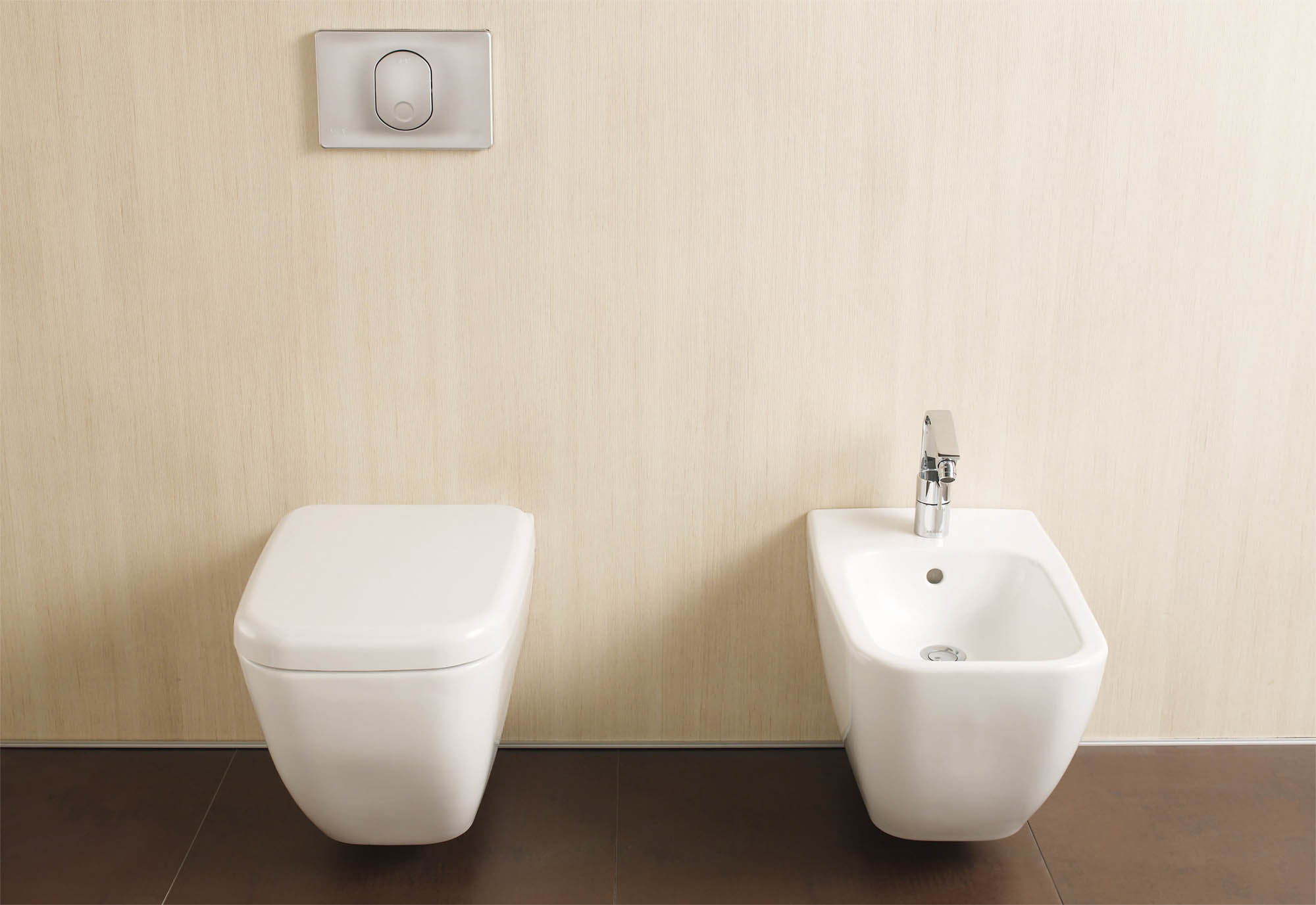 matching modern side by side toilet and bidet with electronic wall switch